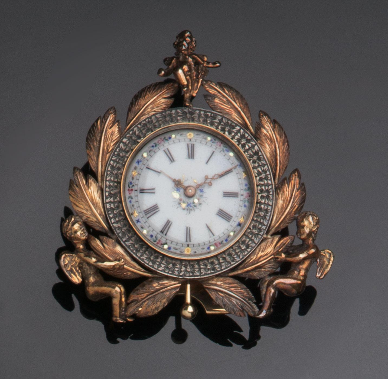 Piccolo orologio da comodino in oro giallo 18 kt