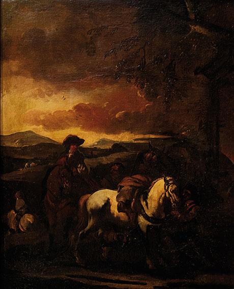 Cavaliere e cavalli in sosta