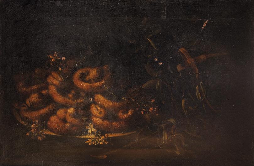 Ciambelle in un piatto di ceramica e fiori d'arancio su un tavolo