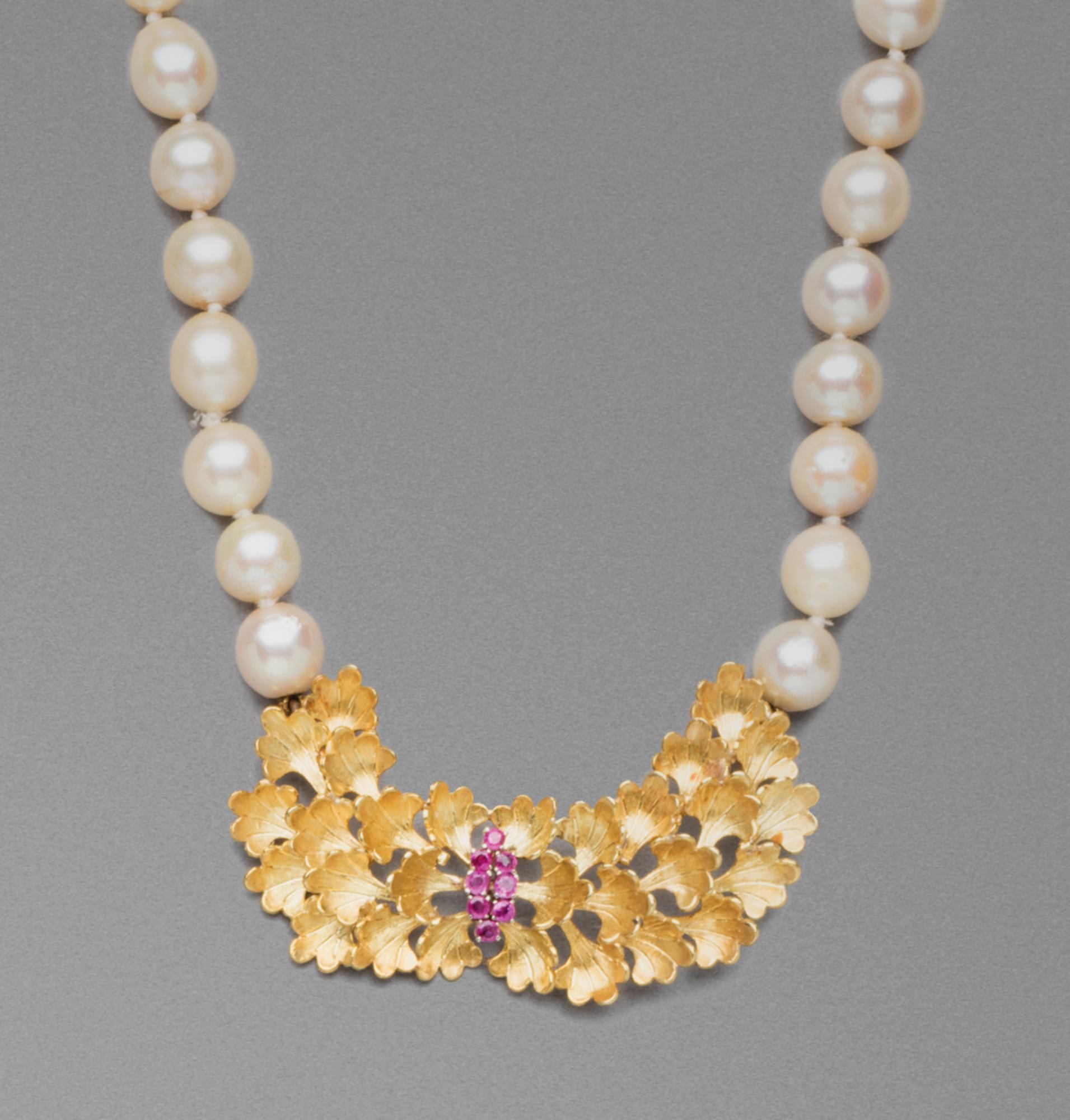 in oro, rubini e perle