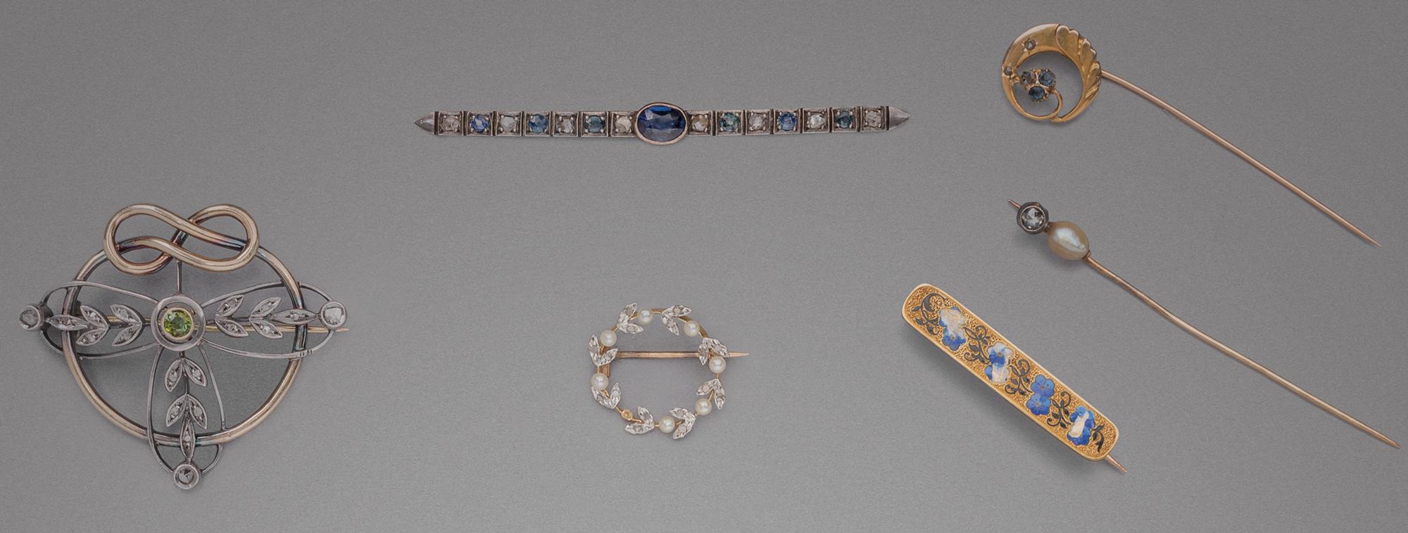 in oro bicolore, argento e pietre