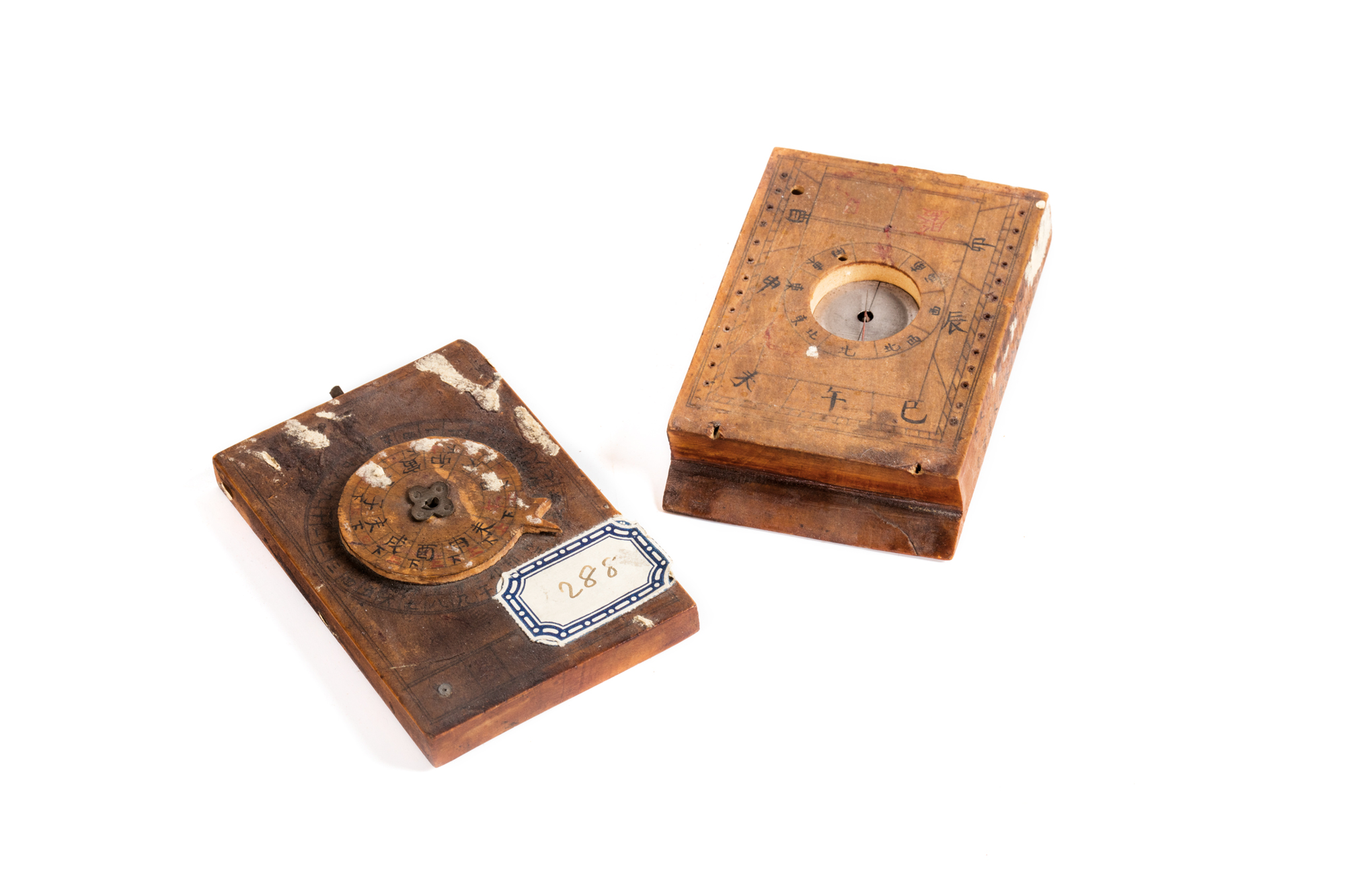 two chinese wooden compasses, late 19th Century, 9 x 6 cm Admiral Lamberto Vannutelli's gift.