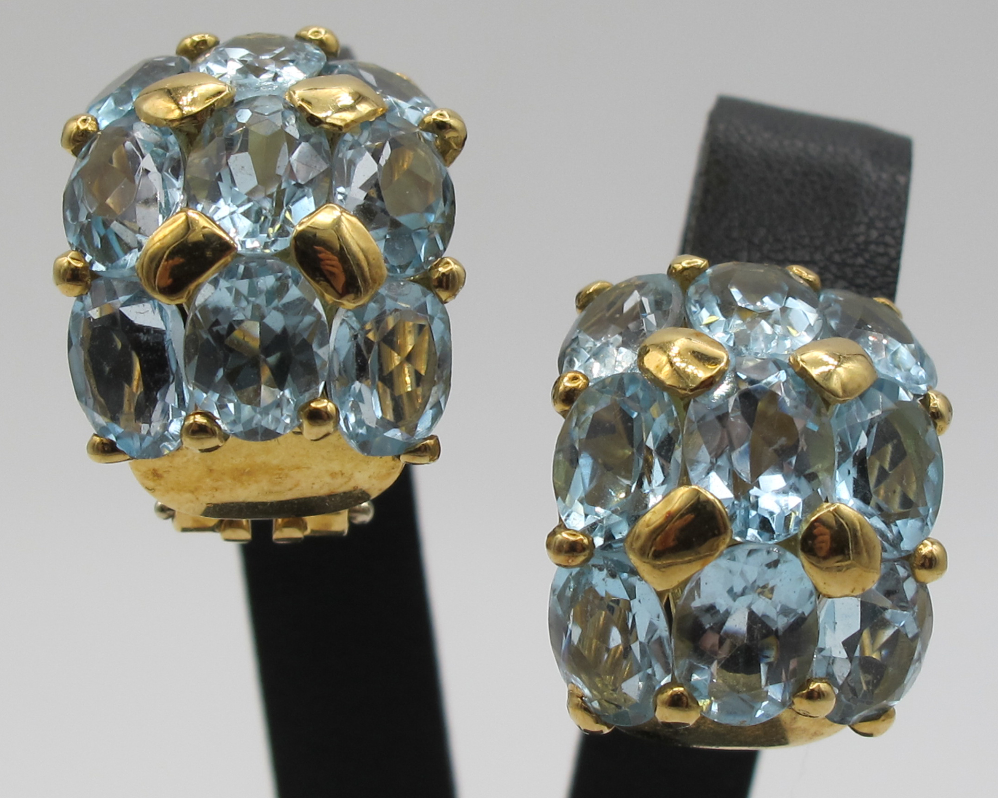 A gold and aquamarine earclips
