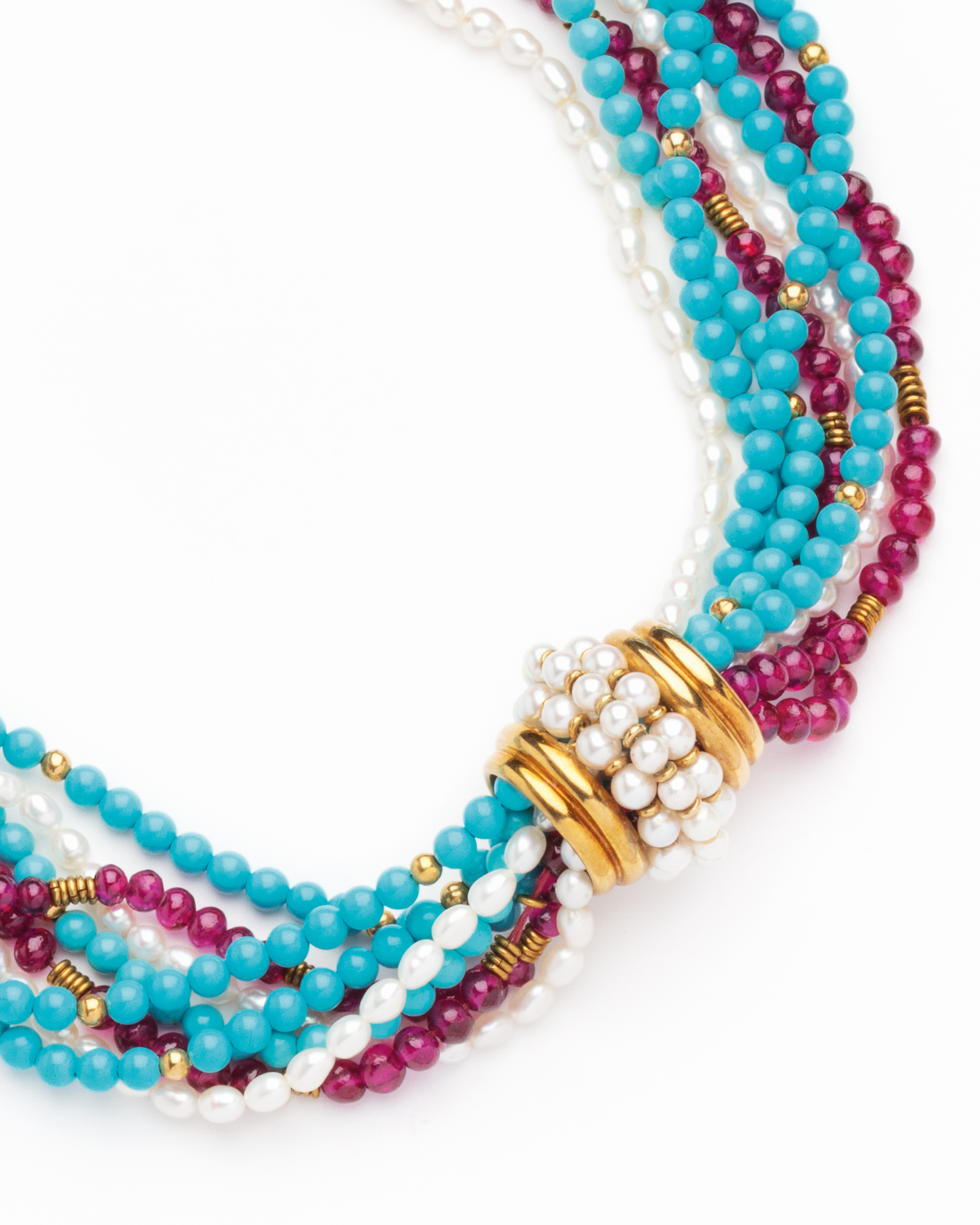 A gold, turquoise, garnet and cultured pearl necklace