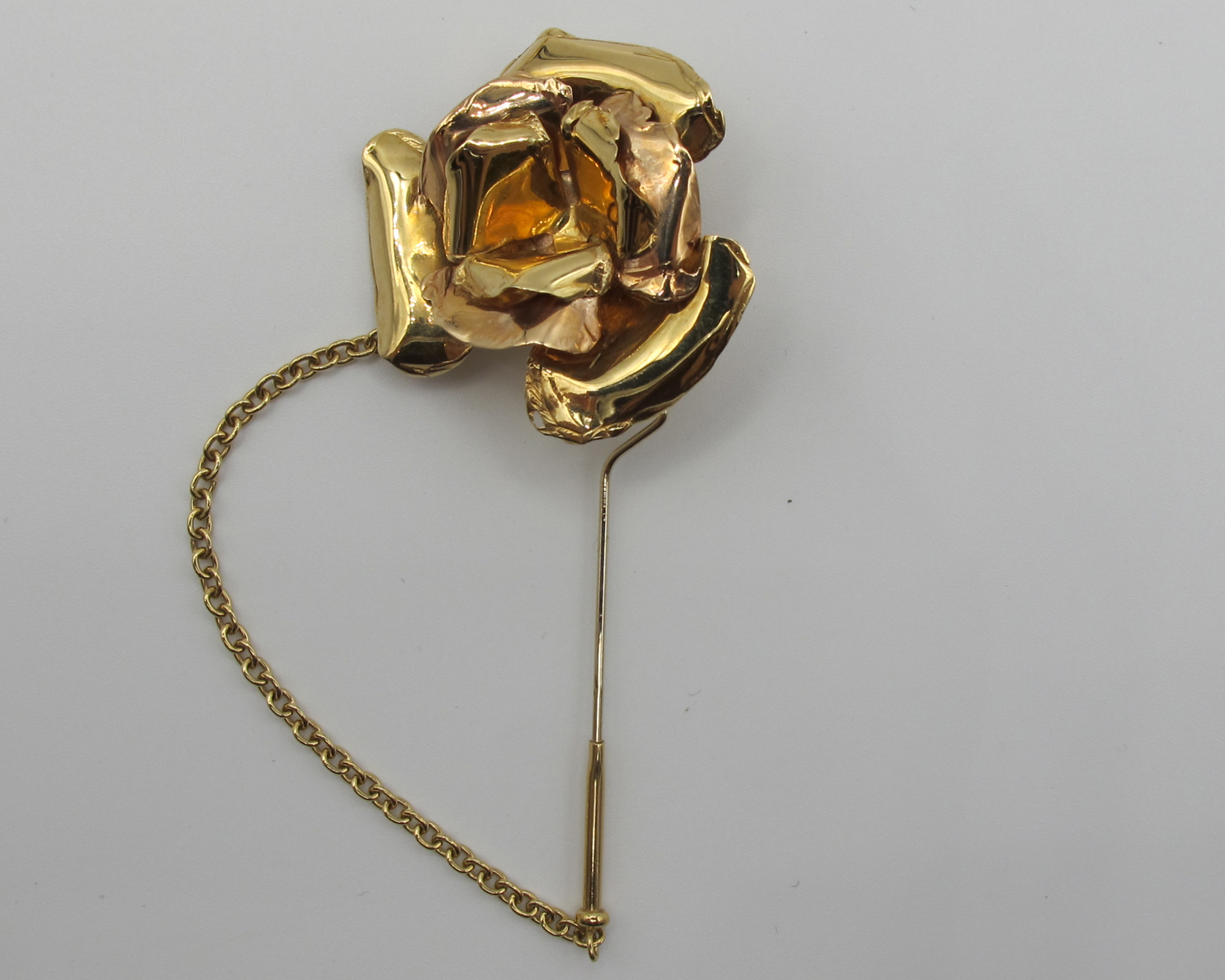 Three gold brooches