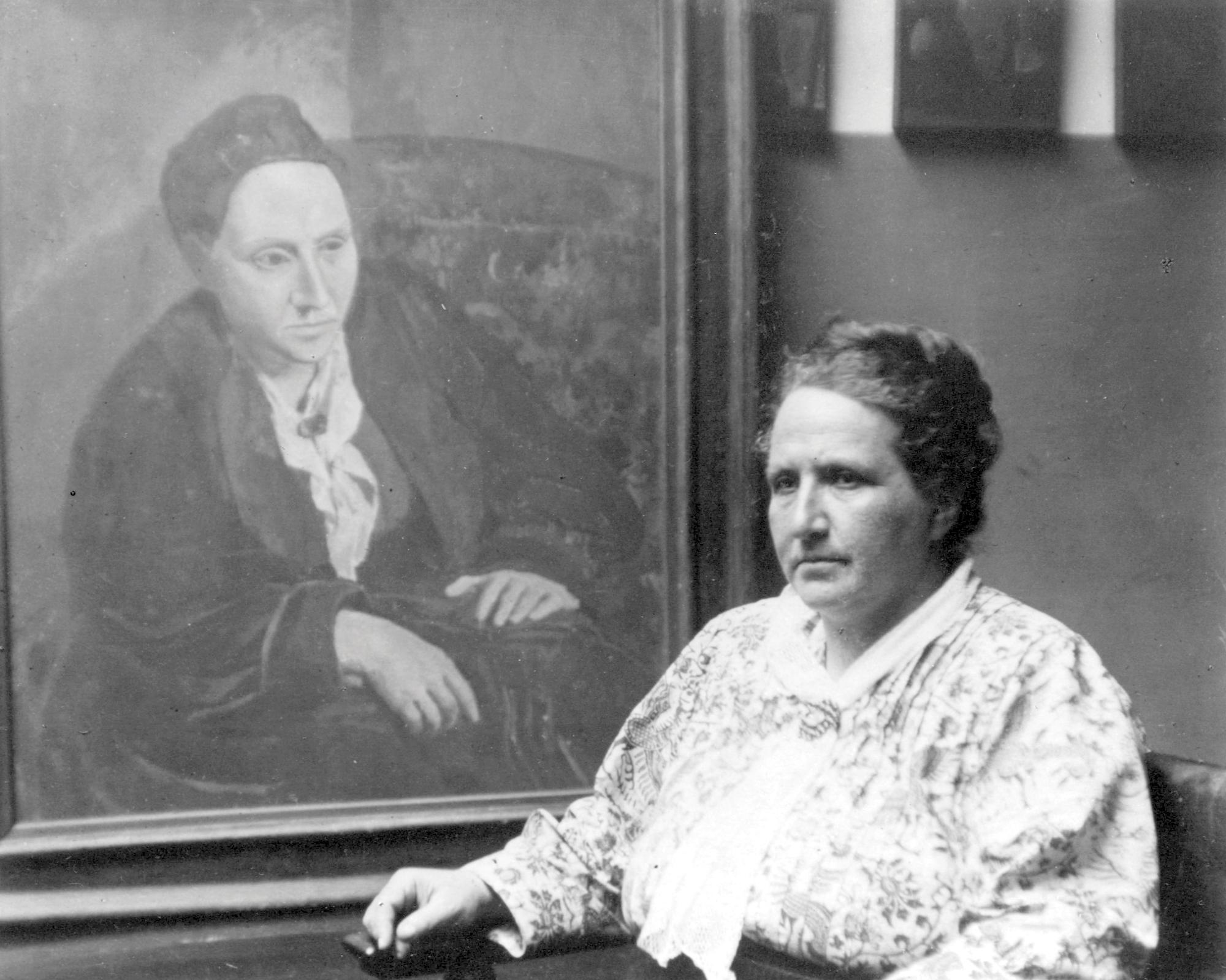 Gertrude Stein con un ritratto di Picasso, 1922