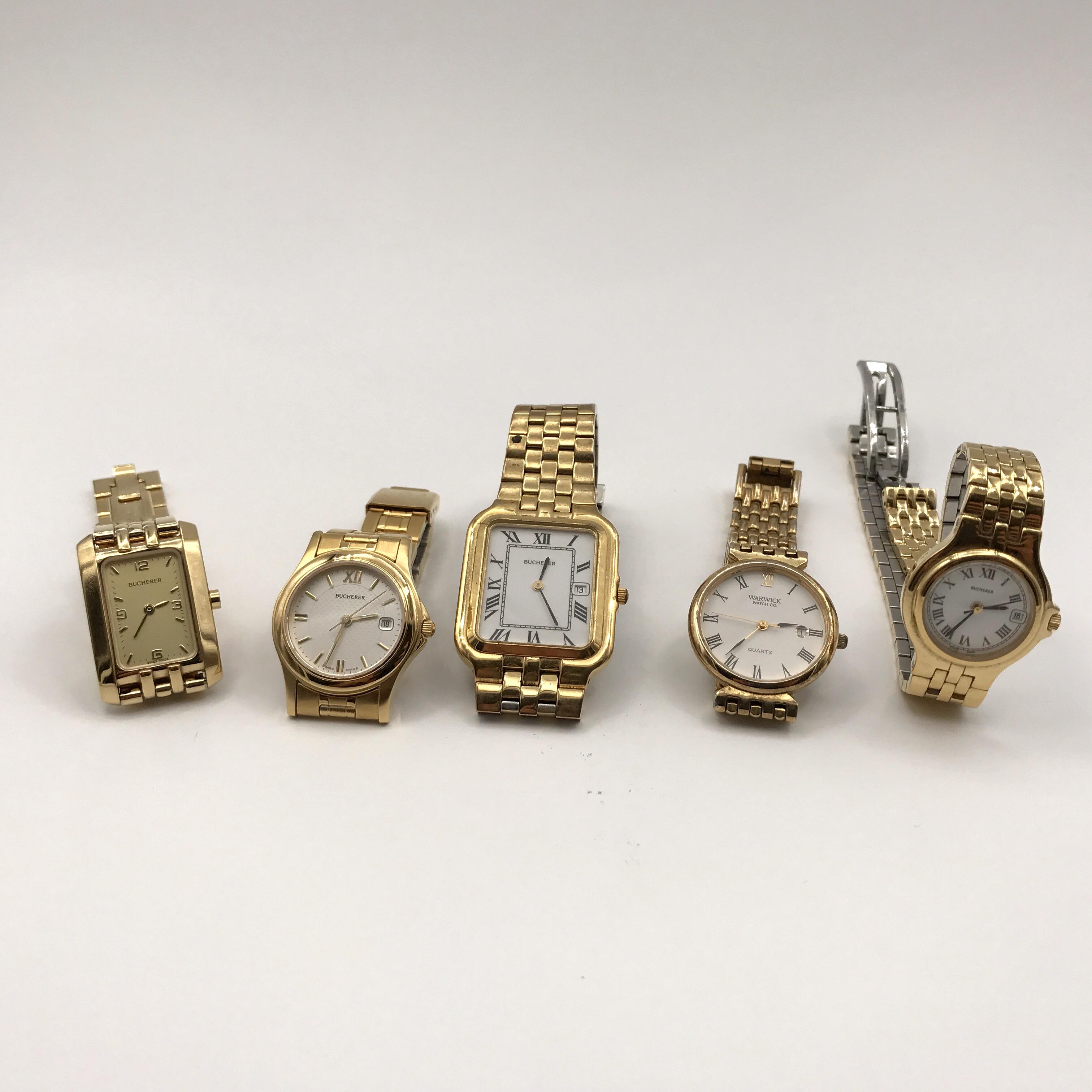 cinque orologi in metallo dorato