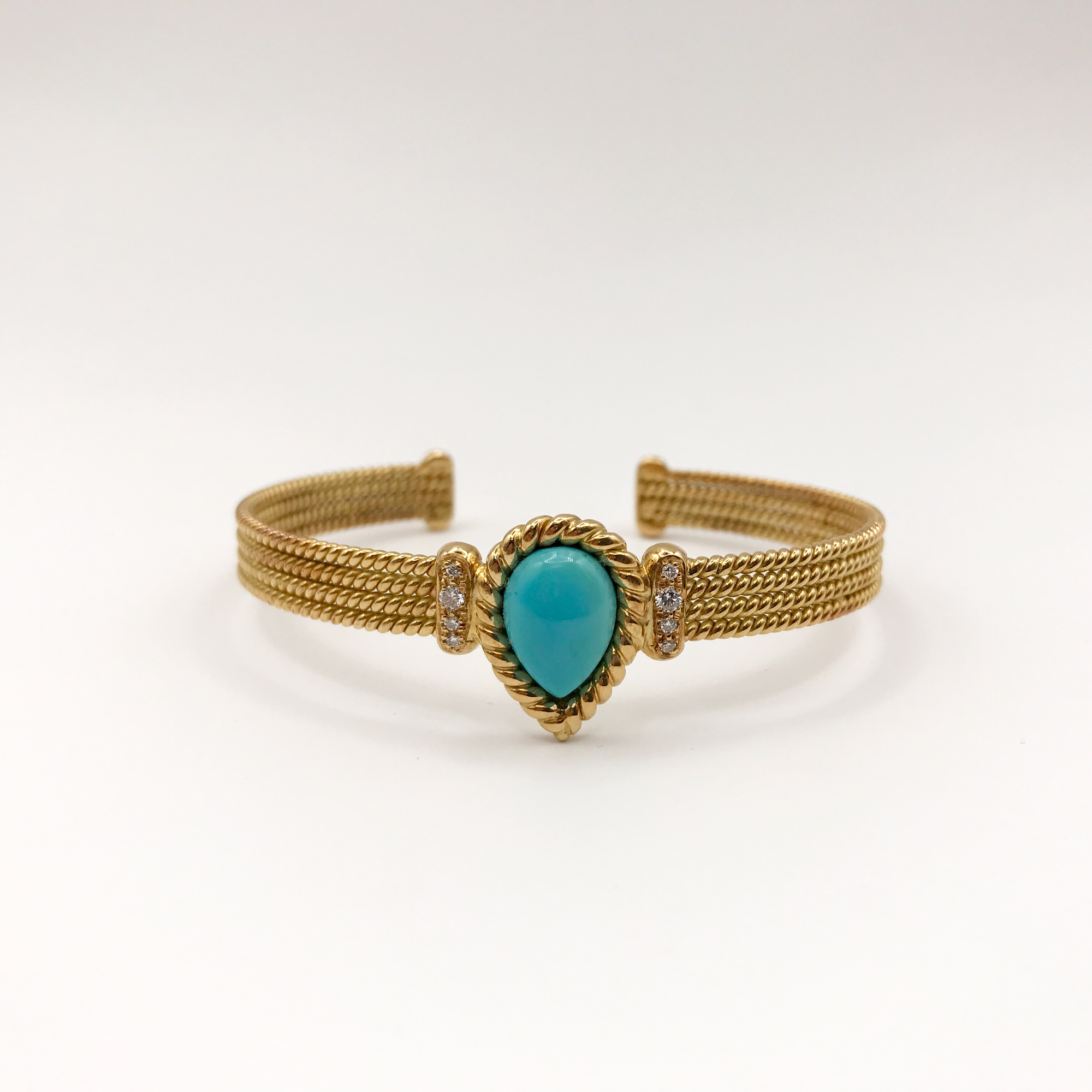 in oro, turchese e diamanti