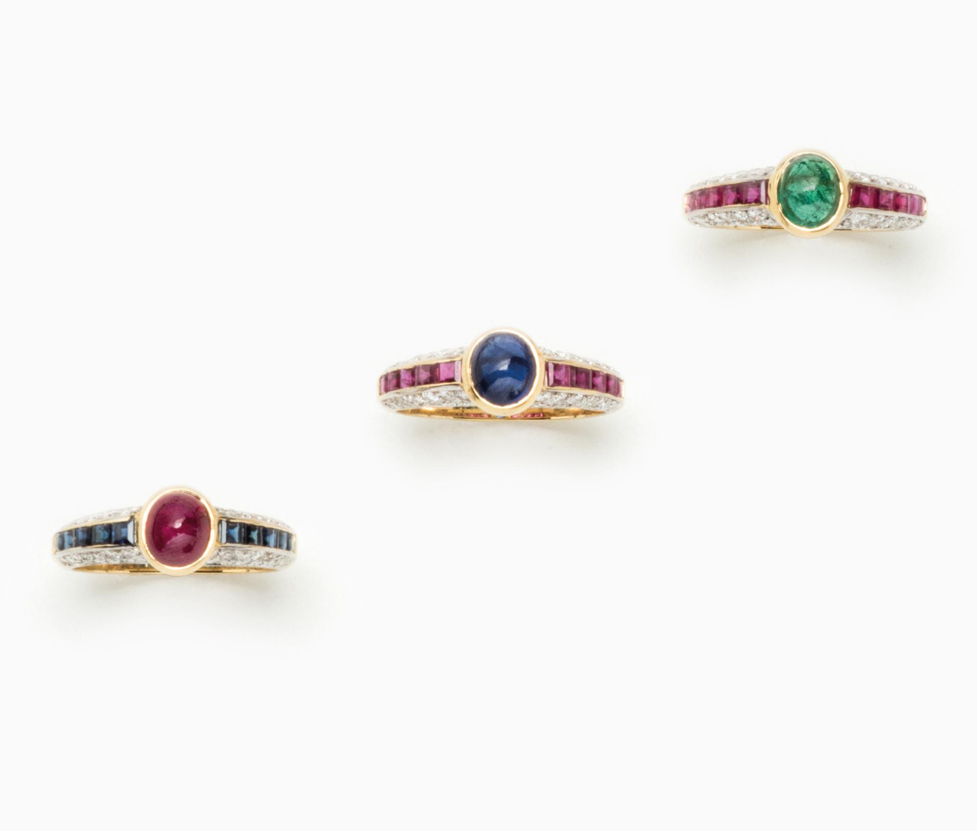 in oro bicolore, rubini, zaffiri, smeraldi e diamanti