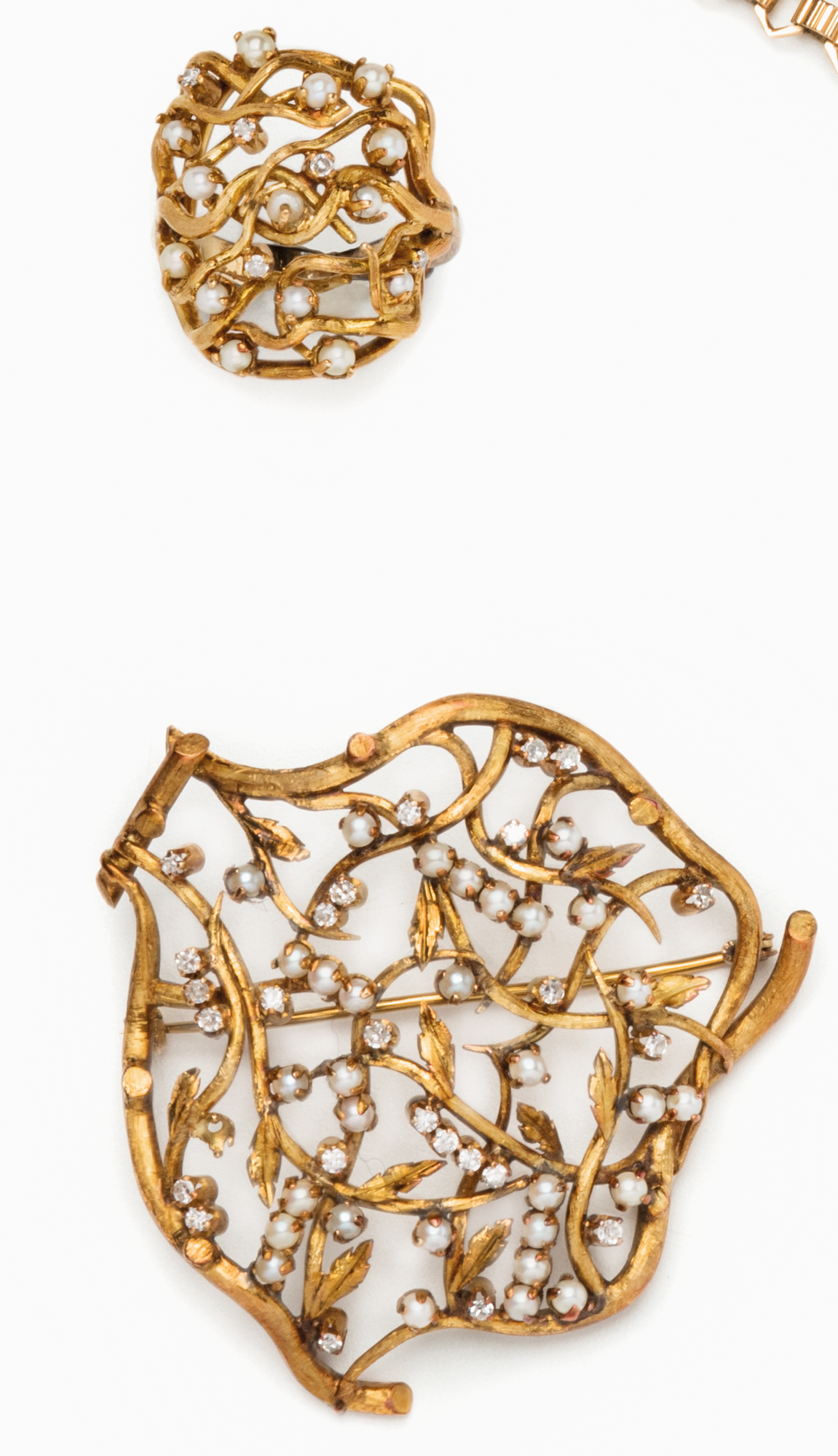 in oro, microperle e diamanti