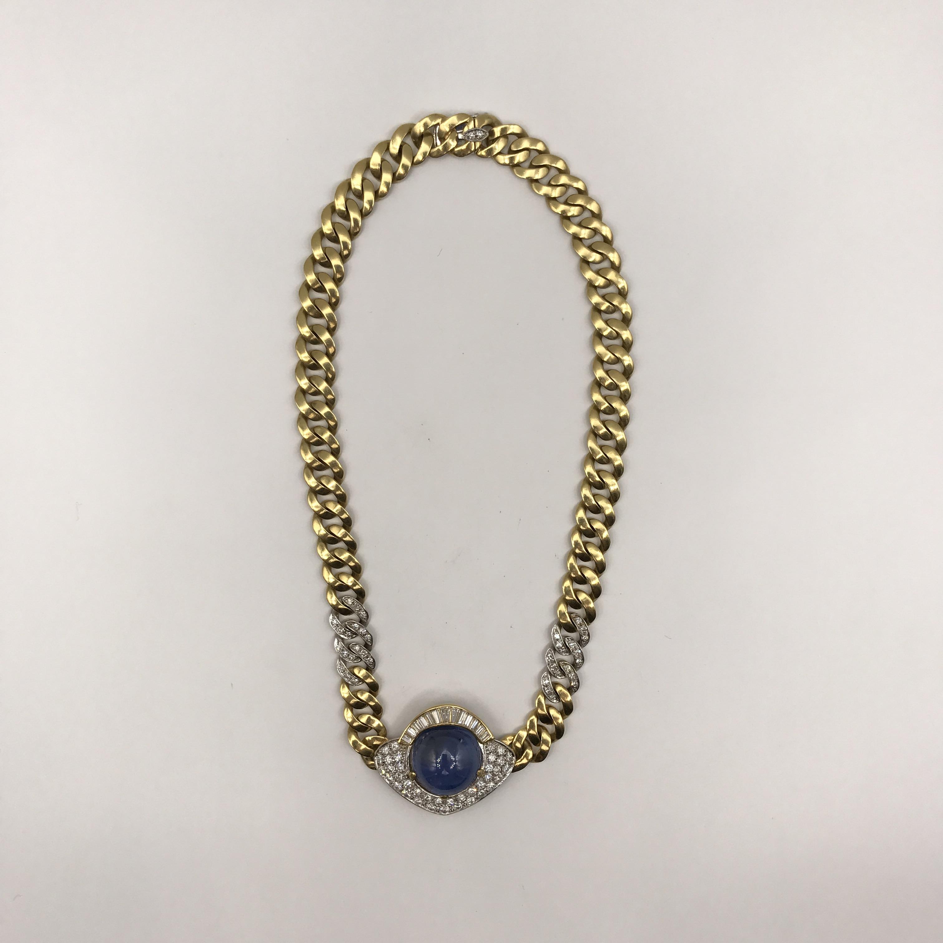 in oro bicolore, zaffiro e diamanti