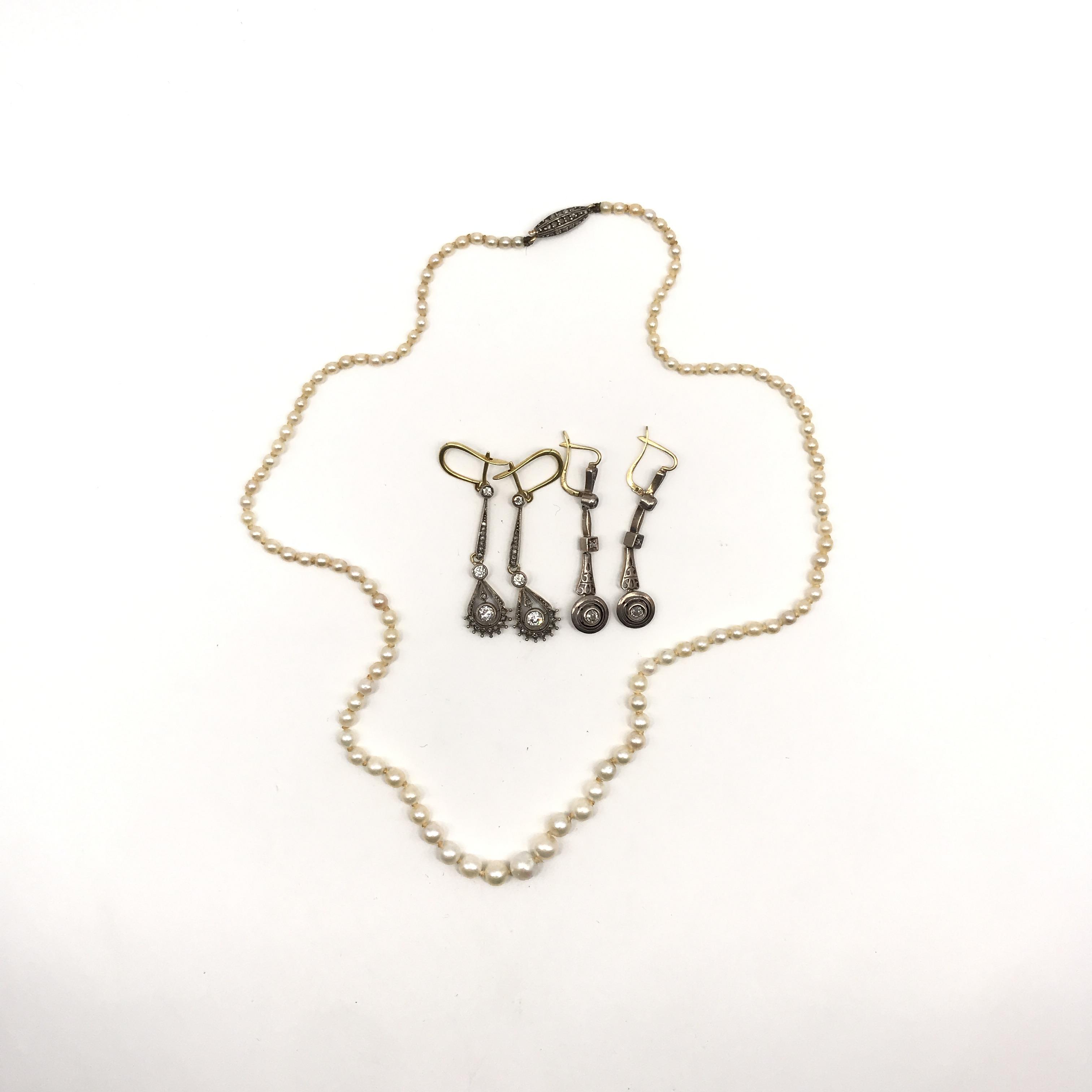 in perle naturali, argento, oro e diamanti
