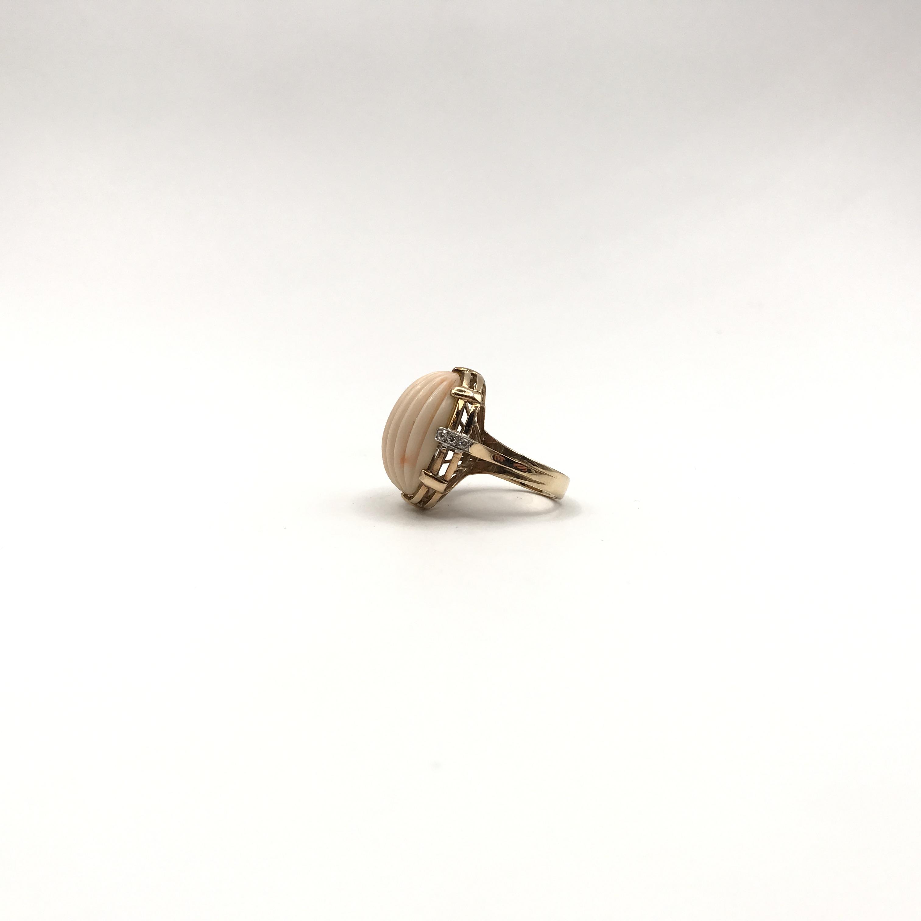 in oro bicolore 14kt, corallo e diamanti