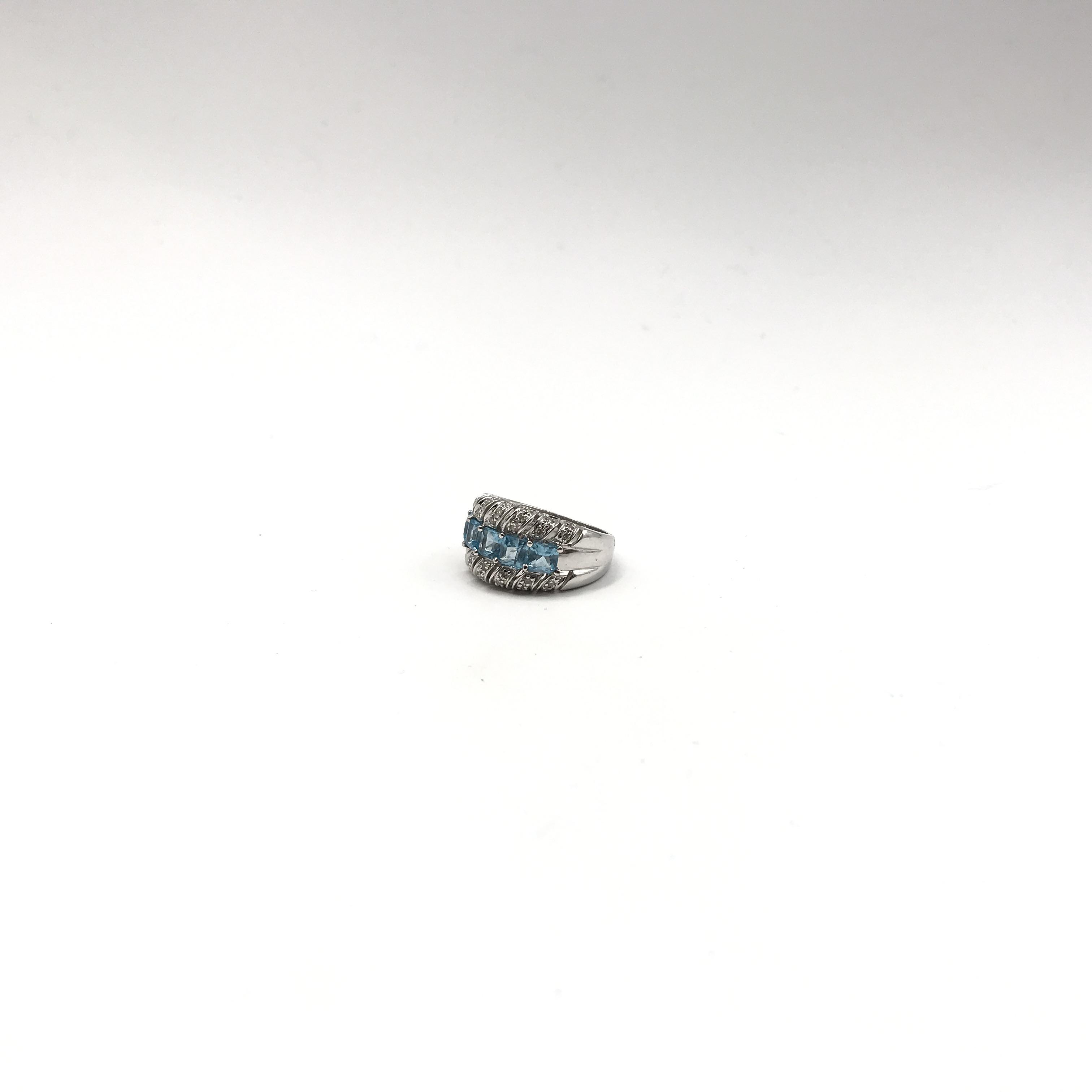 in oro 14kt, topazi azzurri e diamanti