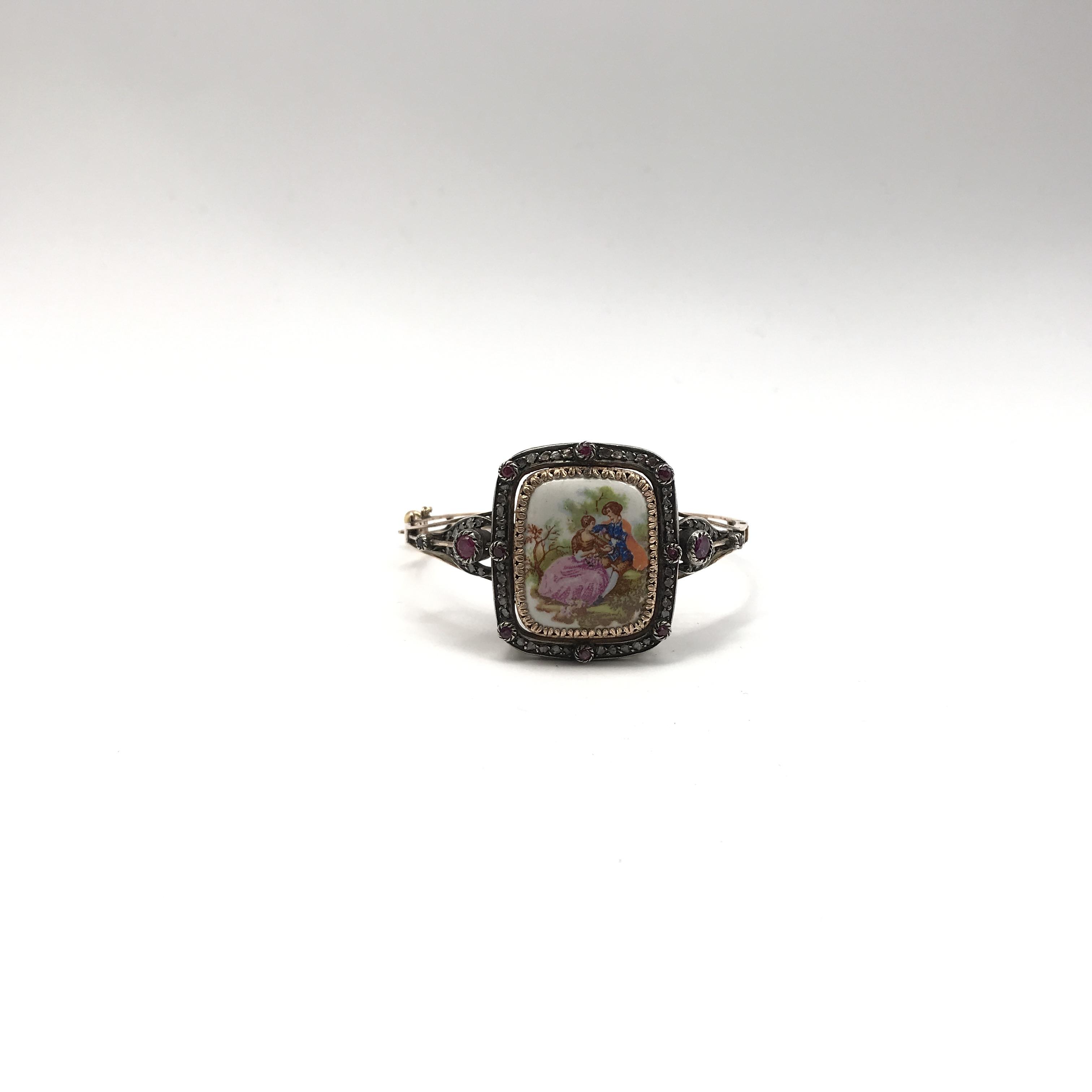 in argento, oro bassa caratura, rubini e diamanti