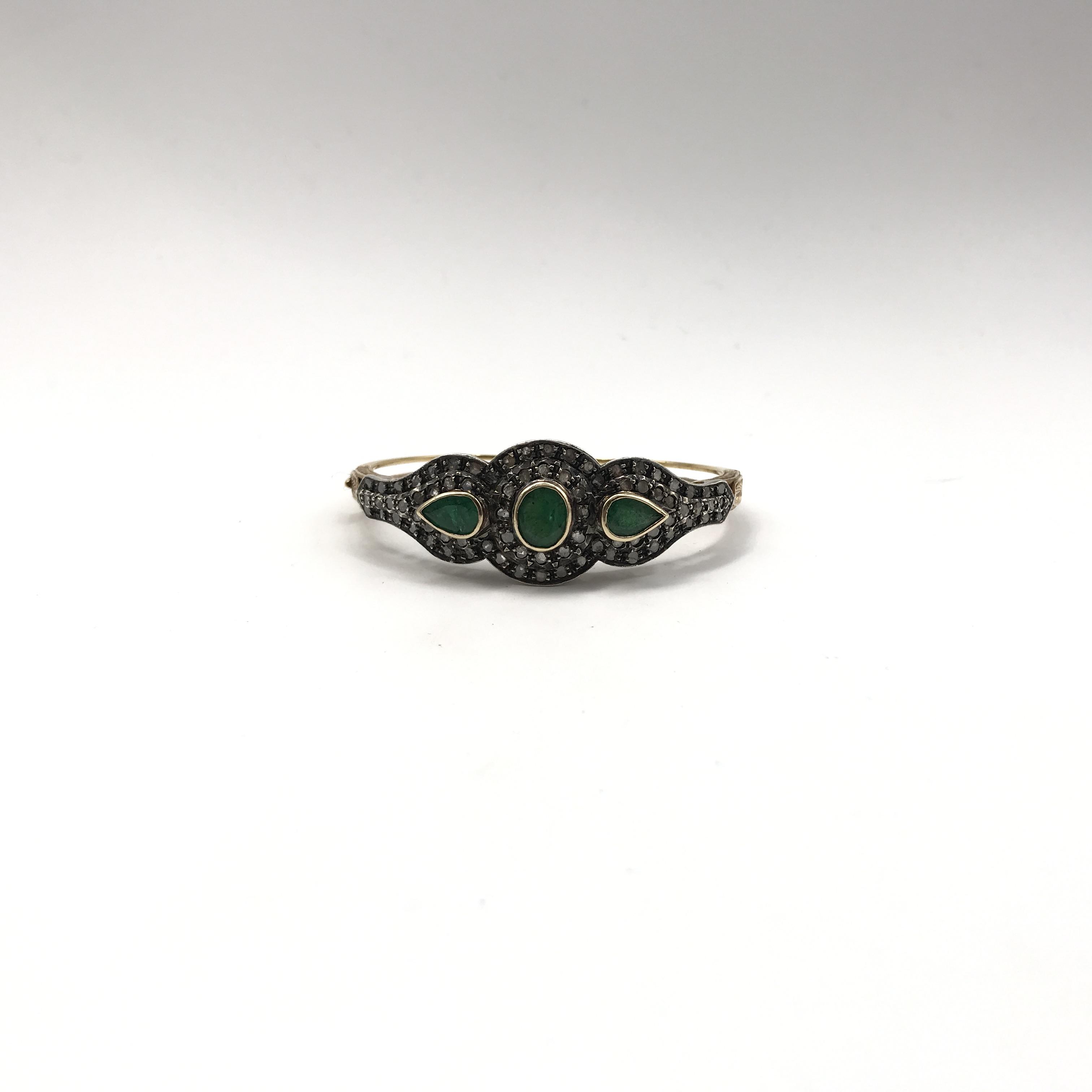 in argento, oro 18kt, smeraldi e diamanti