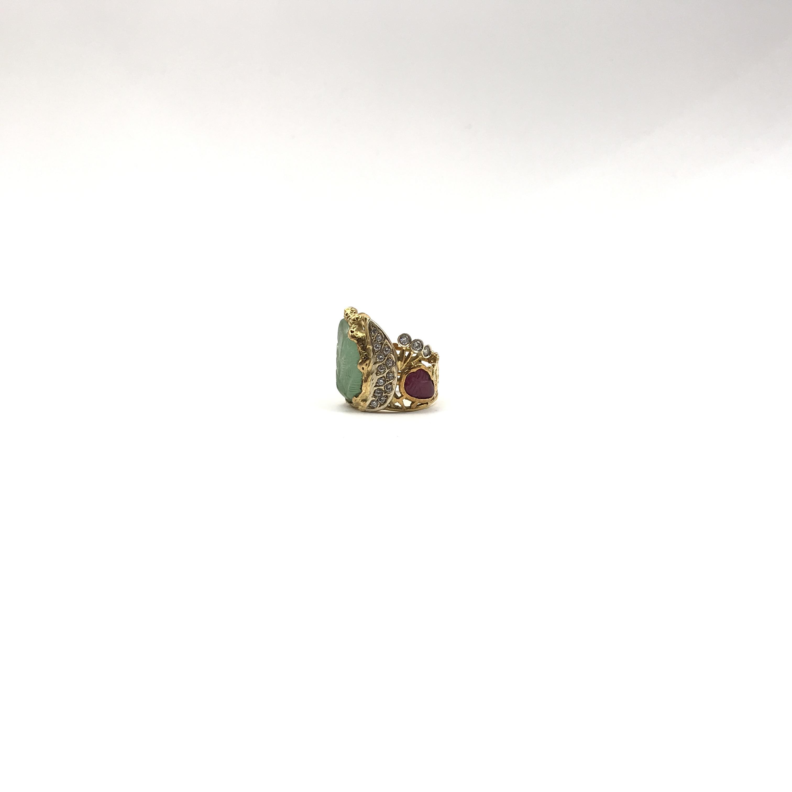 in oro bicolore 18kt, rubini, smeraldo e diamanti