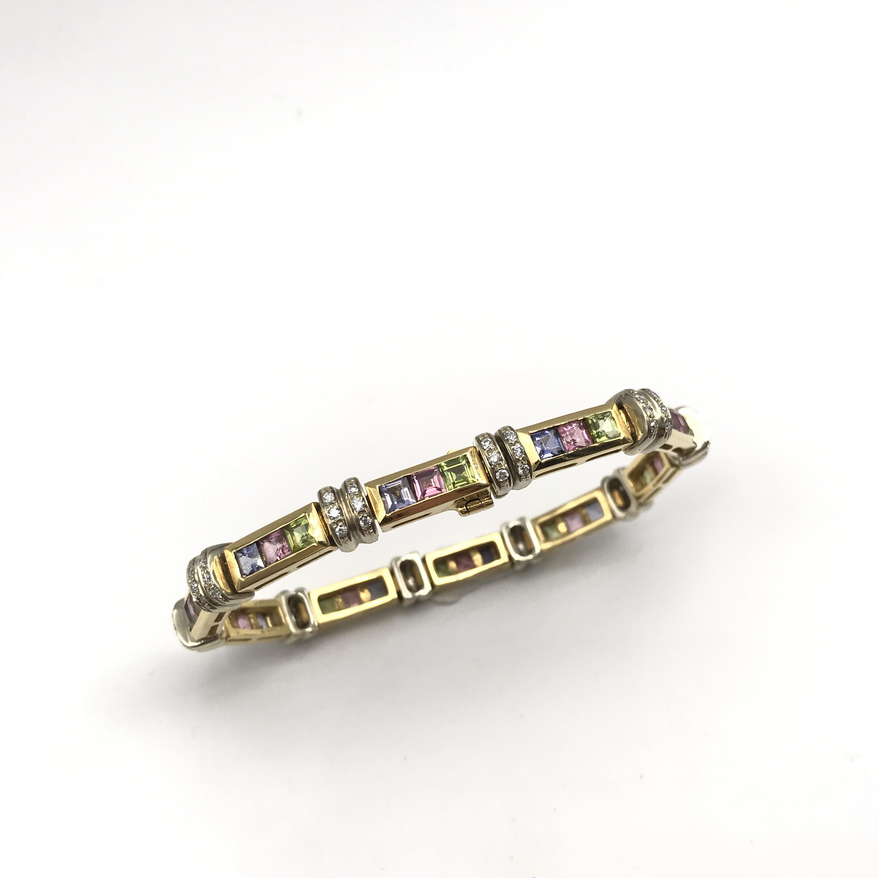 in oro bicolore 18kt, pietre colorate e diamanti